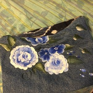 Hand painted Roses on denim clutch bag.